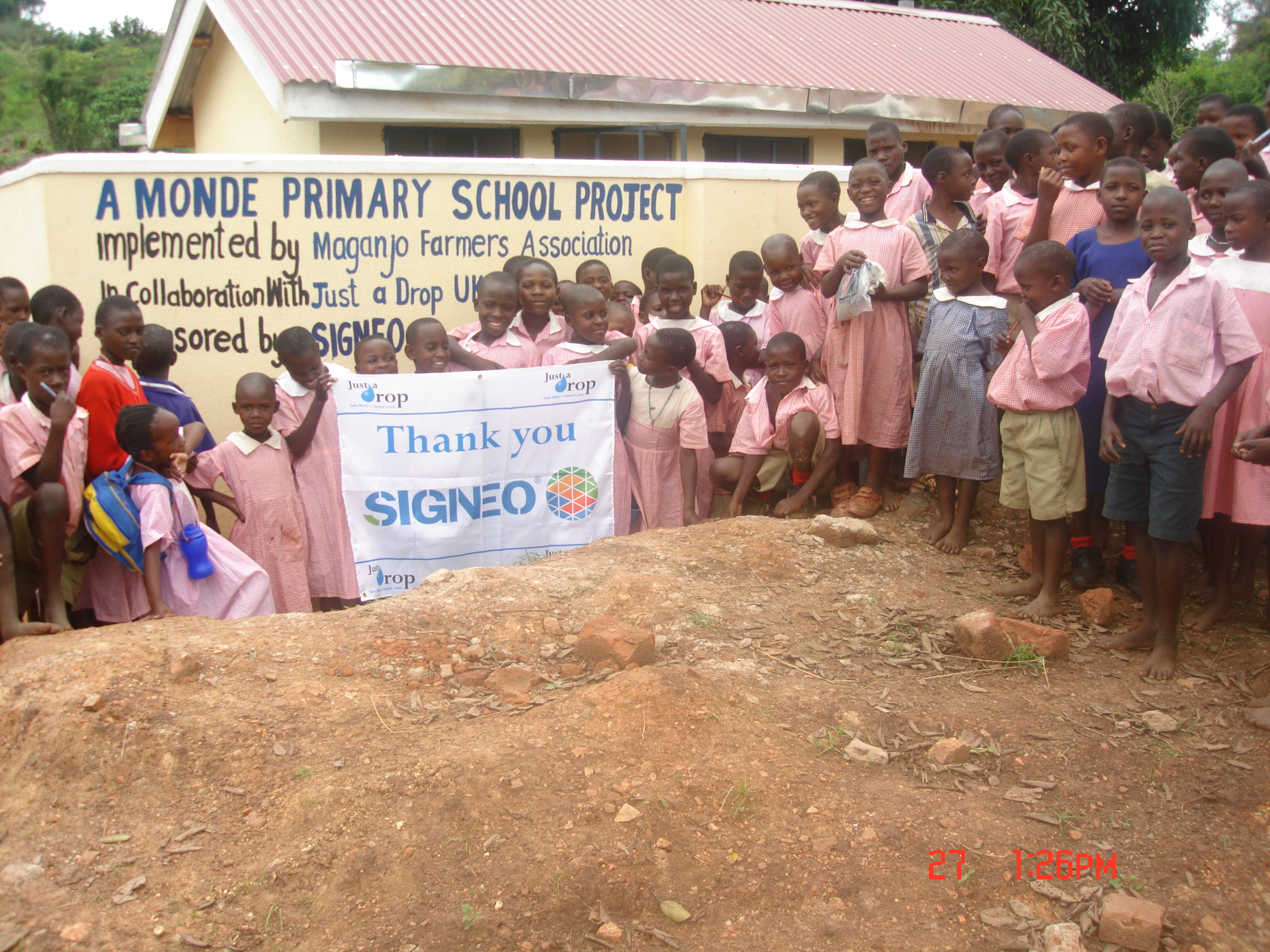 Cerebrate for good sanitation' children from Monde primary school in Luweero District are happy about the newly constructed toilets by CESA-Uganda
