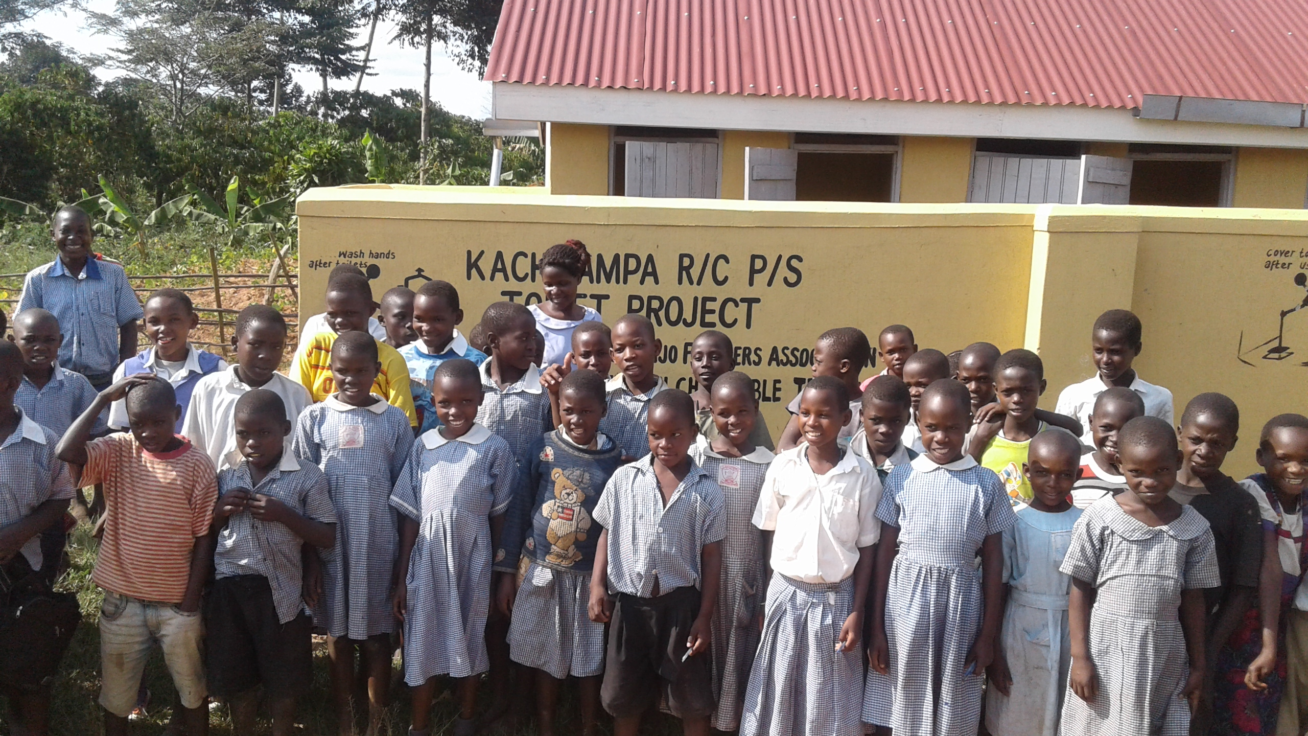 Good sanitation is the way to keep children health, Kanchwampa Rc Primary sch are happy about the new toilets constructed by CESA-Uganda