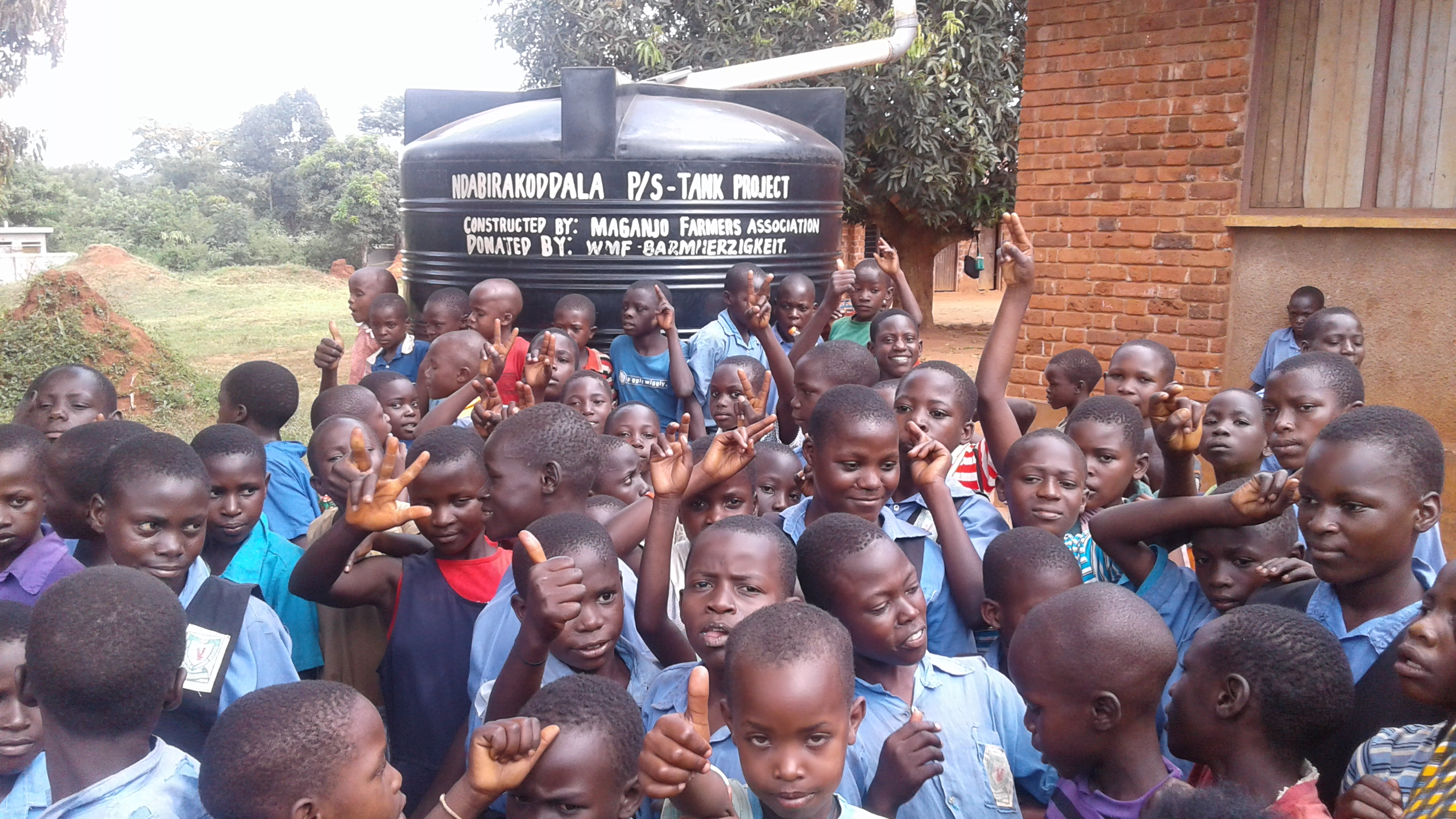 Happy moments, children in Ndabilakoddala primary school cerebrates for a newly constructed tank sponsored by CESA-Uganda